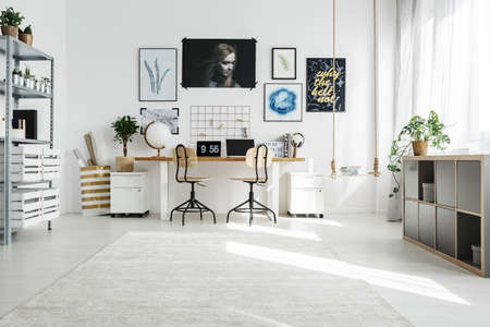 Spacious white home office designed in scandi style