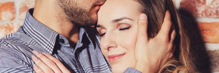 Close up of loving relationship tenderly embracing with eyes closed