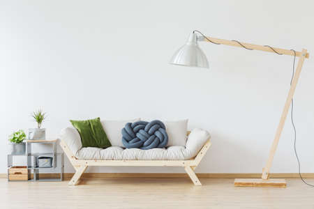 oversize: Wooden stylish sofa in modern, nordic apartment