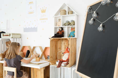 Clean fresh girls room in nordic style with handmade desk