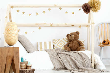 Wooden girls bedroom in scandinavian design with handmade accessories Reklamní fotografie