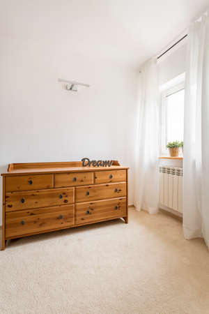 Wooden and brown wardrobe in a white room 版權商用圖片