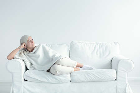 Young woman resting after chemo in her home