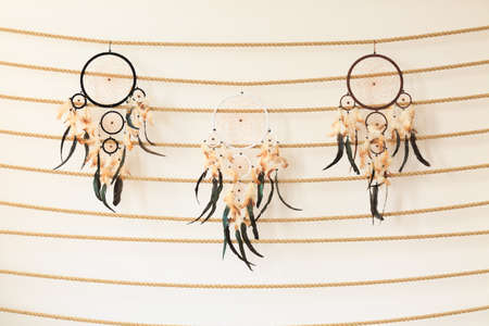 Three big dreamcatchers hanging on a rope in the bedroom