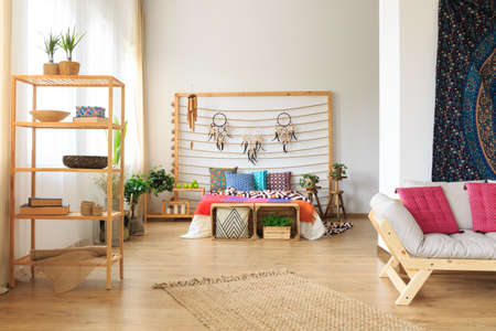 Colorful bed with cushions in a bright room Stock fotó