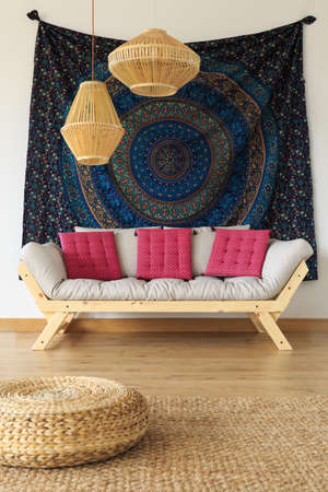 Two wooden lampshades hanging above the sofa Stock Photo