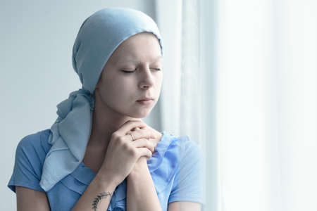 Married woman with cancer faithfully praying for miracle of healing Stock fotó - 81931429