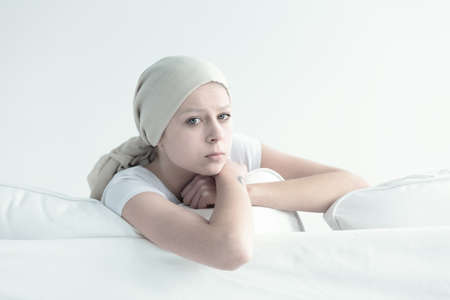 Sad look of woman suffering from cancer disease