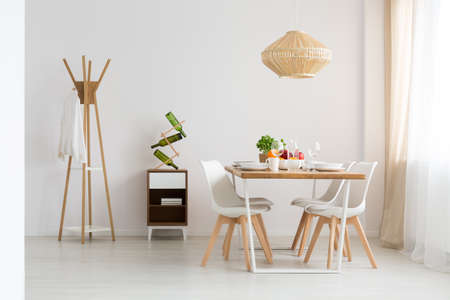 Dining zone in modern, minimal, bright studio