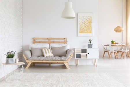 White brick wall and wooden furniture in  apartment