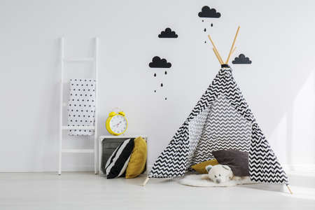 Black and yellow kid room with tipi Stock Photo