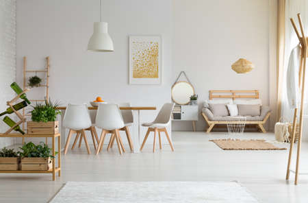 White and modern dining room with wooden furniture