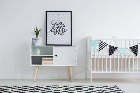 Cute minimalism in in nursery with vintage furniture