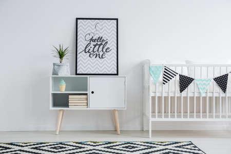 Cute minimalism in in nursery with vintage furniture