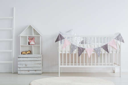 White, vintage baby furniture set in scandi room Stok Fotoğraf