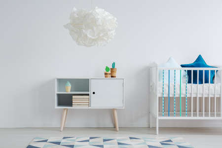 White, blue and turquoise sweet kid room Фото со стока