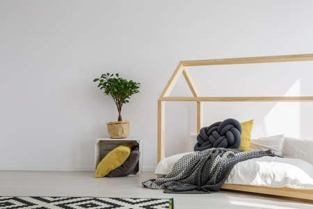 Wooden house bed in stylish kids bedroom