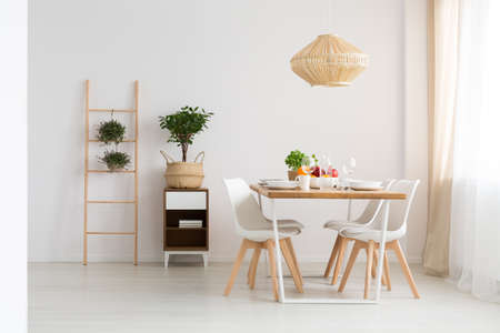 Bright minimal dining room in slow life trend 免版税图像