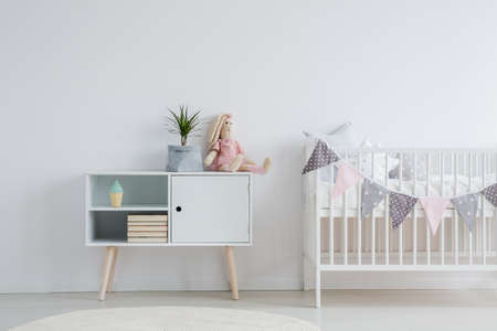 White, nordic furniture set for baby room