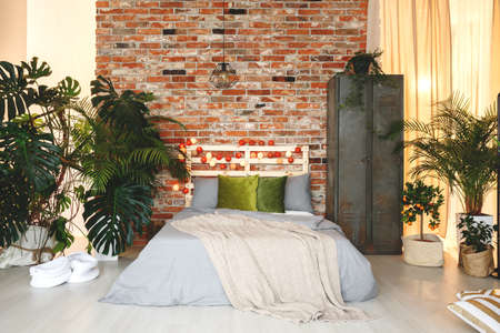 Eco, natural bedchamber with fancy, exotic plants.