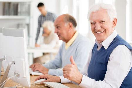 Happy grandpa enjoys learning about modern technology