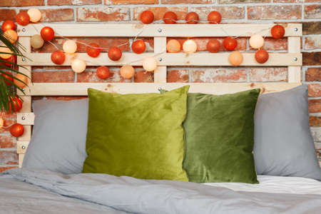 Stylish pillows, diy headbord and warm cotton balls Stock Photo