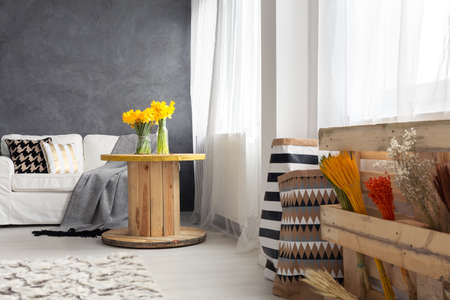 Raw but cosy style in living room Banco de Imagens