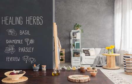 Kitchenette with blackboard wall and big worktop