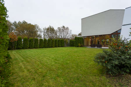 Enormous green garden in stylish designed residence Stock Photo