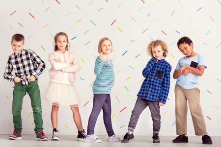 Young sweet happy kids standing in line Stock Photo