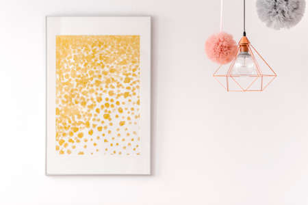 Golden glitter dots poster on the white wall