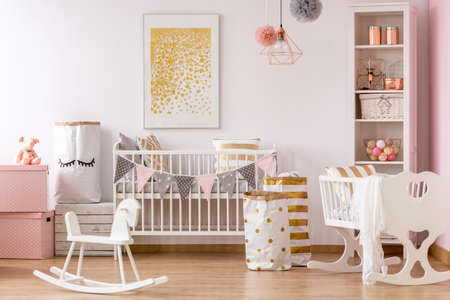 Bright crib nook with golden dots poster and golden accents
