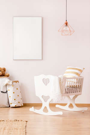 Baby cradle and mockup poster frame in scandinavian interior Stok Fotoğraf