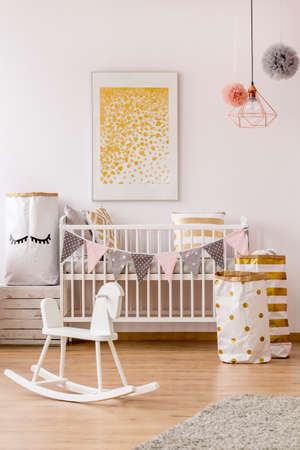Modern newborn corner with golden decor and glitter dots poster