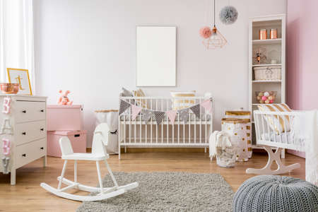 White poster mockup over crib in pastel baby room Stock Photo - 81653107