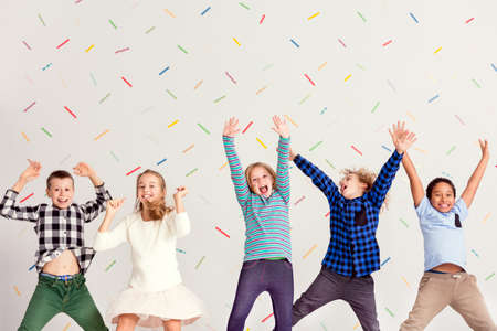 Young happy children jumping and laughing together
