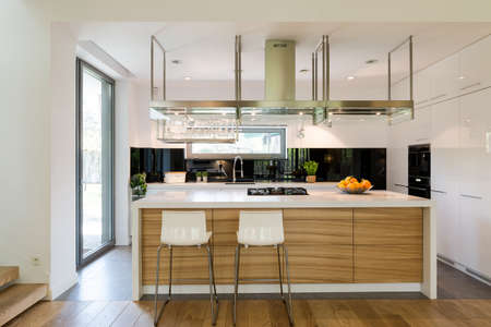 Open plan of kitchen area with a modern kitchen island chairs and kitchen amenities Stock & Open Plan Of Kitchen Area With A Modern Kitchen Island Chairs ...