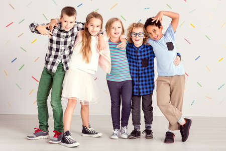 Young sweet children standing together in line Stock Photo