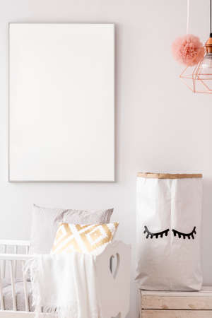 Baby nursery with white poster mockup and storage paper bag Banco de Imagens