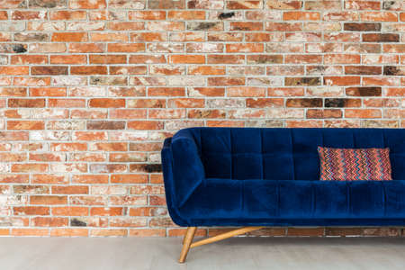 Navy blue sofa and ethnic pillow on it Stock Photo