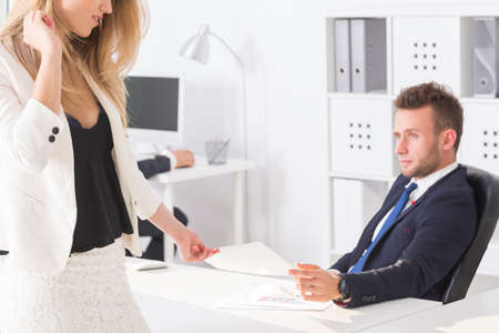 Young man and his beautiful female boss at work Stock Photo