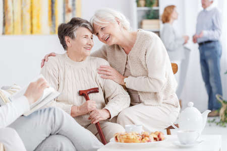 Two older best friends spending time together in nursing home Фото со стока