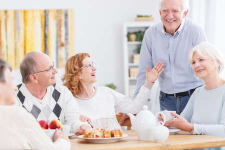 third age: Happy senior people spending afternoon together at home Stock Photo