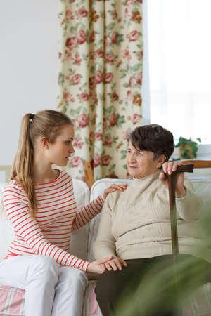 Pretty teenage girl worrying about her grandma