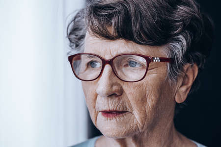 headaches: Sad older lady worrying her memory problems