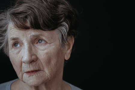 Tired sad face of an older woman Stock Photo