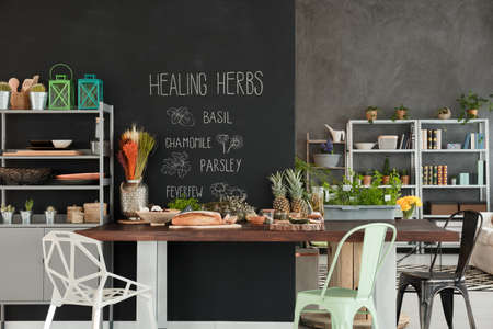 Herbs and healthy food on the table in modern kitchen 版權商用圖片