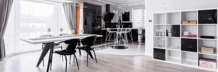 Graphic dining room with modern kitchen annex