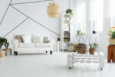 White spacious living room with wooden stylish furniture