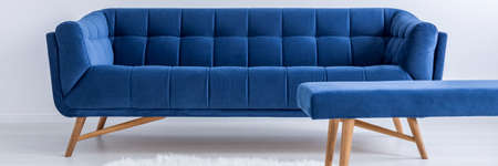 Blue furniture in white minimalistic living room